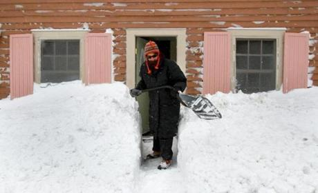 Saira Austin shoveled at her Gloucester home, digging out Friday from a big storm that hit the coast hard.